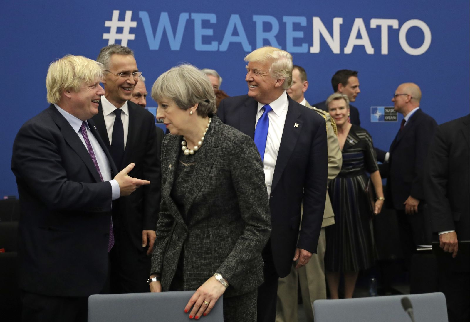 YFILE - In this May 25, 2017, file photo, U.S. President Donald Trump jokes with British Foreign Minister Boris Johnson as British Prime Minister Theresa May walks past during a working dinner meeting at the NATO headquarters during a NATO summit of heads of state and government in Brussels. Threatening to upend generations of global order, Trumps week-long European trip will test the strained bonds with some of the United States closest allies before putting him face-to-face with the leader of the country whose electoral interference helped put him in office.  (AP Photo/Matt Dunham, Pool)