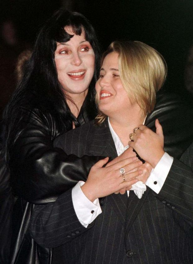 WAS08:CHER-VOTE:WASHINGTON,11OCT96 - Actress Cher hugs her daughter Chastity Bono (R) before speaking at a Human Rights Campaign rally in Washington, October 11. Bono, spokeperson for HRC,  also spoke at  the rally, which was organized to commemorate National Coming Out Day, a call to the lesbian and gay community to vote in the coming presidential elections.  ln/Photo by Luc Novovitch REUTERS