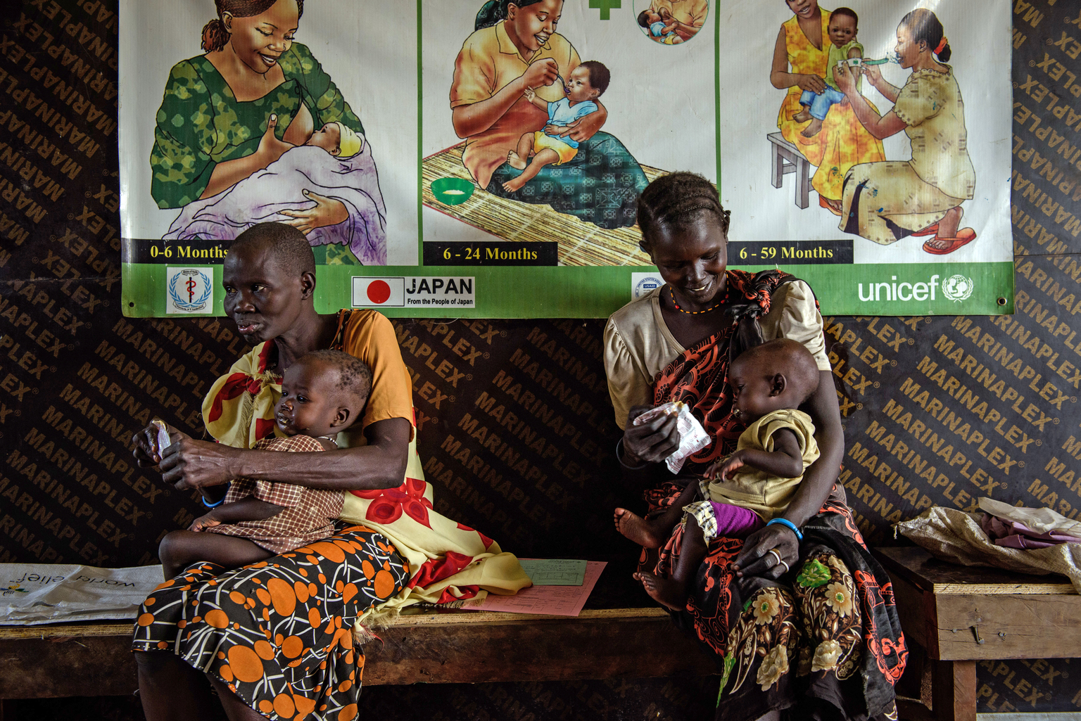 (right) Angelina Nyakan, 30, feeds ready-to-use therapeutic food (RUTF) peanut-paste to her seven-month-old daughter Nyamer Pok during a consultation in the World Relief health centre in the Protection of Civilians site in Bentiu, South Sudan, Wednesday 3 May 2017. Nyamer was enrolled on the outpatient therapeutic programme (OTP) one week ago after being diagnosed with malnutrition. This was the first of several weekly follow-ups, and her condition has improved. Angelina has another child, who is healthy.  The nutrition situation in South Sudan remains dire as the peak lean season approaches. In May 2017, UNICEF and partners screened 149,655 children (six to 59 months) with 6,068 identified with severe acute malnutrition (SAM) and 18,892 with moderate acute malnutrition (MAM). Screenings in nine out of 10 states indicate malnutrition rates above the emergency level. Countrywide, an estimated 5.5 million people are now food insecure.  The security situation across the country remains unstable, severely impacting sustained humanitarian access. UNICEF continues to build upon existing community networks and other community-based resources to assess, plan and implement the humanitarian response, in order to strengthen local capacities and ensure accountability to affected populations.