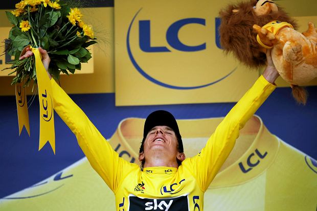 Britain's Geraint Thomas, wearing the overall leader's yellow jersey, celebrates on the podium after the twentieth stage of the Tour de France cycling race, an individual time trial over 31 kilometers (19.3 miles)with start in Saint-Pee-sur-Nivelle and finish in Espelette, France, Saturday July 28, 2018. (AP Photo/Christophe Ena )
