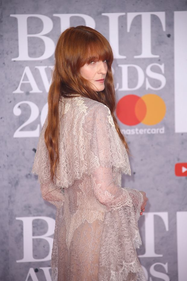 Singer Florence Welch poses for photographers upon arrival at the Brit Awards in London, Wednesday, Feb. 20, 2019. (Photo by Joel C Ryan/Invision/AP)