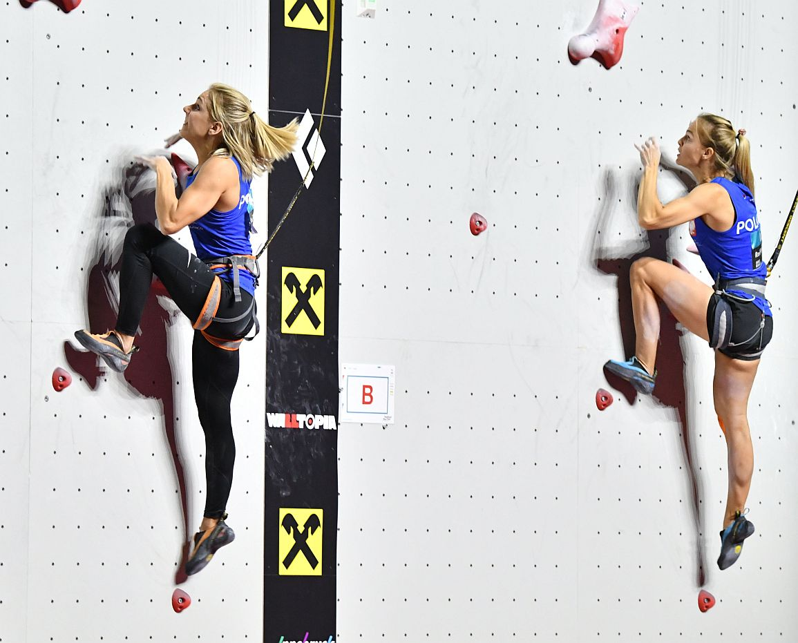 First placed Aleksandra Rudzinska of Poland (L) competes next to compatriot second placed Anna Brozek during the qualification for the womens speed competition at The IFSC Climbing World Championships in Innsbruck on September 13, 2018. (Photo by BARBARA GINDL / APA / AFP) / Austria OUT