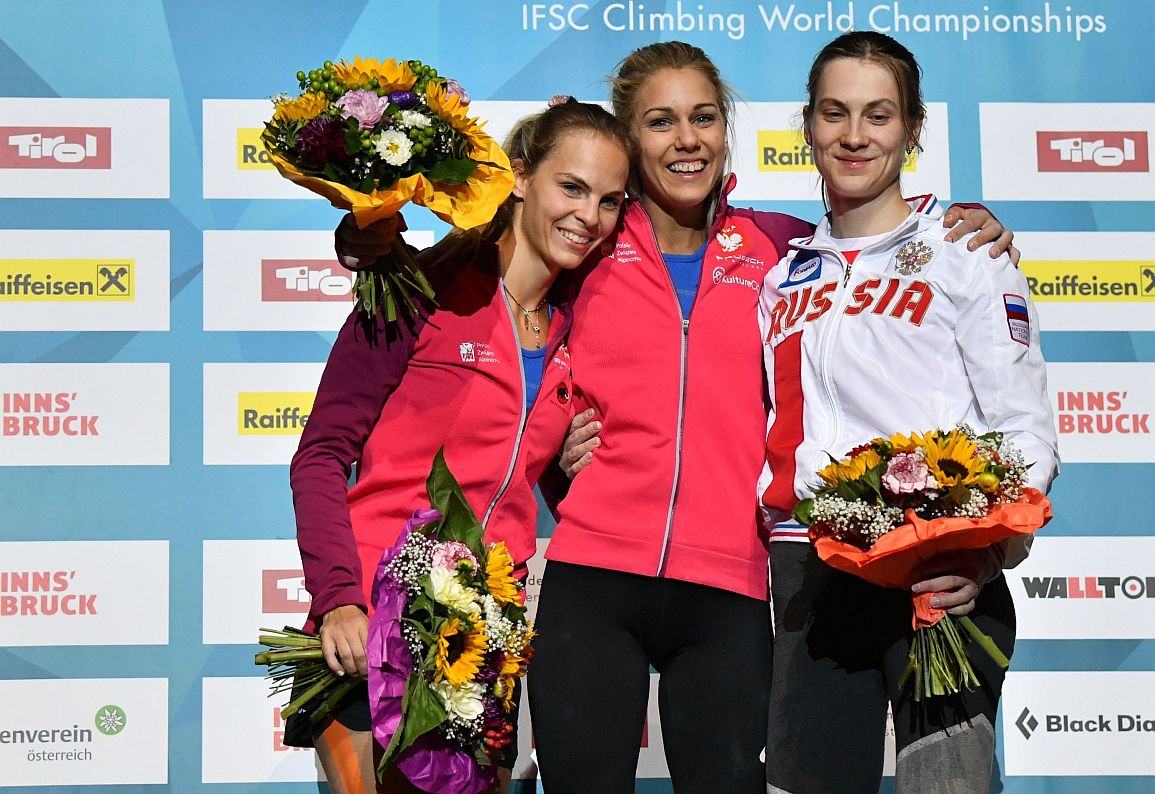C(L/R): Second placed Anna Brozek of Poland, first placed Aleksandra Rudzinska of Poland and third placed Mariia Krasavina of Russia pose during the ceremony for the womens speed competition finalsat The IFSC Climbing World Championships in Innsbruck on September 13, 2018. (Photo by BARBARA GINDL / APA / AFP) / Austria OUT