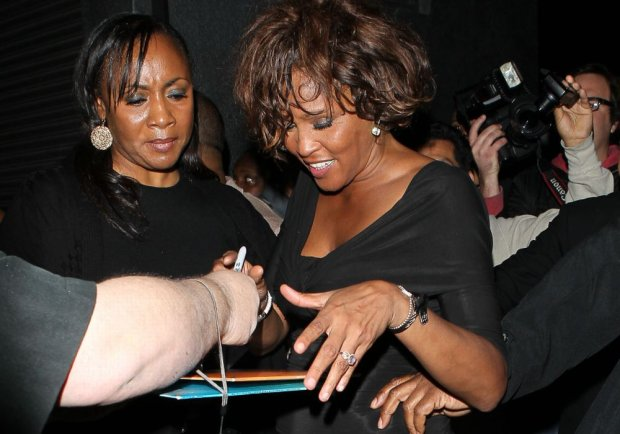 Feb 11, 2012- Pictures taken on Feb 09, 2012 - Los Angeles CA - Whitney Houston leaving club Tru in Hollywood CA                                                               Ref# AKM8798                                                                          Credit : AKM Images.                                                                                       For Liscensing Contact: Alex or Thaissa at Sales@akmimages.net                                                    Office:  +1 424.237.2908 *** Local Caption ***  Whitney Houston, Bobby Brown and Bobbi Kristina