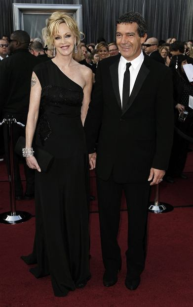 Melanie Griffith, left, and husband Antonio Banderas arrive before the 84th Academy Awards on Sunday, Feb. 26, 2012, in the Hollywood section of Los Angeles. (AP Photo/Matt Sayles)