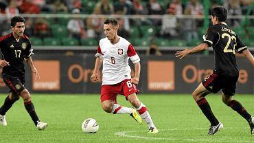 Pomocnik Adam Matuszczyk podczas meczu Polska - Meksyk, 2011 r.