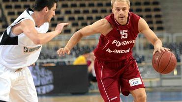 Łukasz Koszarek (z piłką) w reprezentacji Polski