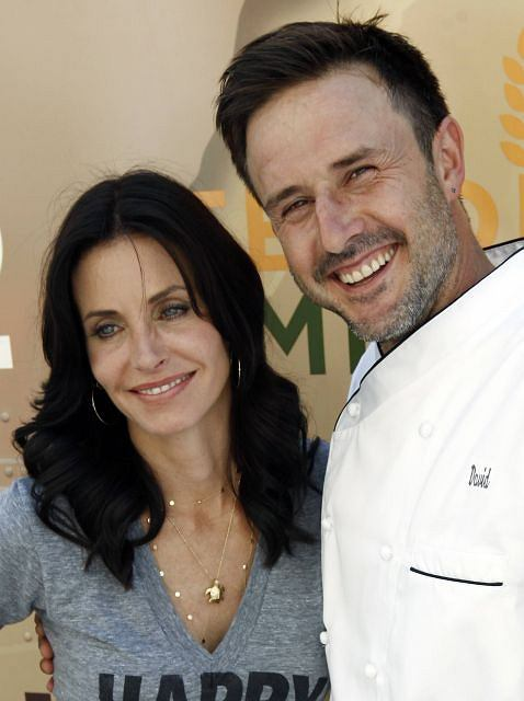 FILE - In this Aug. 31, 2009 file photo, David Arquette, right, and Courteney Cox Arquette pose together at the launch of The Cheesecake Factory's Drive Out Hunger Tour benefiting Feeding America in Culver City, Calif.  (AP Photo/Matt Sayles, file)