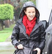 Mandatory Credit: Photo by BDG / Rex Features ( 1262747b )  Reese Witherspoon sheltering from the rain  Reese Witherspoon out and about, Brentwood, Los Angeles, America - 18 Dec 2010