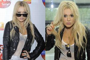 Doda była największą gwiazdą konferencji polsatowskiego festiwalu, Top Trendy 2011. To ona była rozchwytywana przez dziennikarzy, a paru poświęciła chwilkę i odpowiedziała krótko na kilka pytań. Tego dnia nie była jednak w humorze, ale jej nawet z gniewem jest do twarzy:). Wybrała rockowy look i wyglądała rewelacyjnie! Co Doda miała na sobie? Kurtka i spodnie- Burberry Prorsum, buty - Giuseppe Zanotti, koszulka - TopShop ,okulary - RayBan. Wow!