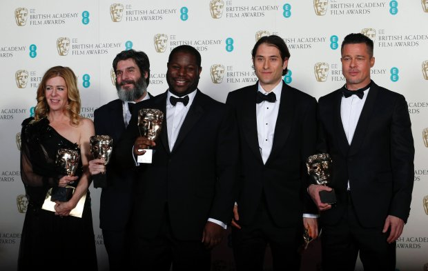 "Director Steve McQueen (C) celebrates with Dede Gardner (L-R), Anthony Katagas, Jeremy Kleiner and Brad Pitt after winning Best Film for ""12 Years a Slave"" at the British Academy of Film and Arts (BAFTA) awards ceremony at the Royal Opera House in London February 16, 2014.         REUTERS/Suzanne Plunkett (BRITAIN - Tags: ENTERTAINMENT)"