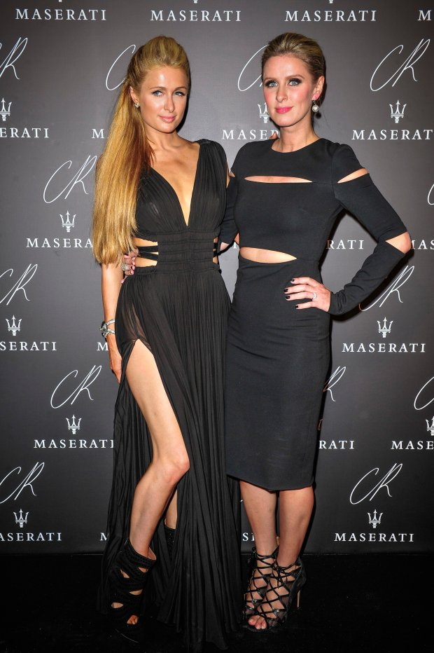 Paris Hilton,left, and Nicky Hilton pose at Carine Roitfeld & Stephen Gan celebration of the launch of CR Fashion Book N.5 in Paris, Tuesday, Sept. 30, 2014.(AP Photo/Zacharie Scheurer)