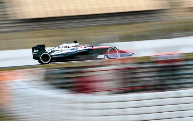 Jenson Button of Great Britain steers his McLaren Honda car during the 2015 Formula One testing at the Barcelona Catalunya racetrack in Montmelo, Spain, Friday, Feb. 27, 2015. (AP Photo/Manu Fernandez)