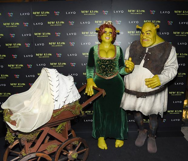 Model and television personality Heidi Klum, left, and boyfriend Tom Kaulitz dressed as Shrek and Princess Fiona arrive at her 19th annual Halloween party at Lavo New York on Wednesday, Oct. 31, 2018, in New York. (Photo by Evan Agostini/Invision/AP)