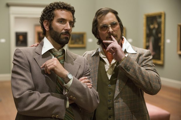 Richie Dimaso (Bradley Cooper, left) and Irving Rosenfeld (Christian Bale) talk in a gallery at the Frick Museum in Columbia Pictures AMERICAN HUSTLE.Richie Dimaso (Bradley Cooper, left) and Irving Rosenfeld (Christian Bale) talk in a gallery at the Frick Museum in Columbia Pictures AMERICAN HUSTLE.CC