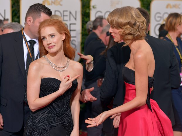 Jessica Chastain, left, and Taylor Swift arrive at the 71st annual Golden Globe Awards at the Beverly Hilton Hotel on Sunday, Jan. 12, 2014, in Beverly Hills, Calif. (Photo by John Shearer/Invision/AP)