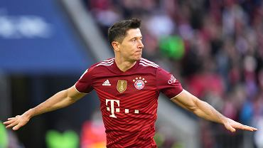 Bayern's Robert Lewandowski celebrates after scoring his side's second goal during the German Bundesliga soccer match between Bayern Munich and TSG 1899 Hoffenheim