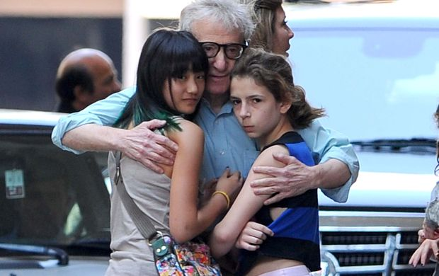 "Beverly Hills, CA - Woody Allen stands outside The Regent Beverly Wilshire Hotel hugging his adopted daughters, Bechet and Manzie Tio, as he waits for the limo to arrive.  Woody's wife, Soony-Yi was around as well chatting away with a friend.  Woody has been busy premiering his newest film, ""To Rome with Love"".      AKM-GSI          June 15, 2012    To License These Photos, Please Contact :    Steve Ginsburg  (310) 505-8447  (323) 4239397  steve@ginsburgspalyinc.com  sales@ginsburgspalyinc.com    or    Keith Stockwell  (310) 261-8649  (323) 325-8055   keith@ginsburgspalyinc.com  ginsburgspalyinc@gmail.com *** Local Caption ***  Woody Allen"