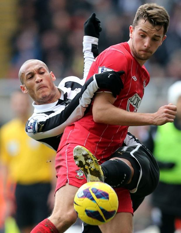 Newcastle United's Yohan Gouffran, left, vies for the ball with Southampton's Jay Rodriguez, right, during their English Premier League soccer match at St James' Park, Newcastle, England, Sunday, Feb. 24, 2013. (AP Photo/Scott Heppell)