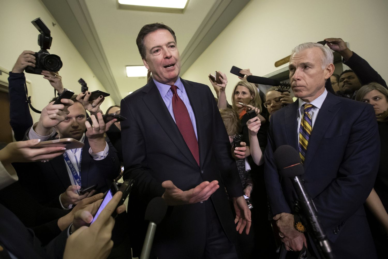 FILE - In this Dec. 7, 2018, file photo, former FBI Director James Comey, with his attorney, David Kelley, right, speaks to reporters after a day of testimony before the House Judiciary and Oversight committees, on Capitol Hill in Washington. (AP Photo/J. Scott Applewhite, File)