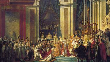 Koronacja Napoleona w katedrze Notre Dame 2 grudnia 1804 r. Obecny na ceremonii wielki malarz Jacques-Louis David wiernie ją odtworzył, przez co dzieło traktowane jest jak dokument historyczny, choć niektórych ukazanych postaci w Notre Dame nie było. Do prac nad obrazem David przystąpił w grudniu 1805 r., a ostatni szlif nadał dziełu w listopadzie 1807 r. Widzimy moment, gdy Napoleon wkłada koronę na głowę Józefiny, bo najprawdopodobniej malarz wolał nie pokazywać samokoronacji Bonapartego w obecności siedzącego za nim papieża. W tym okresie para cesarska była już na granicy rozwodu.