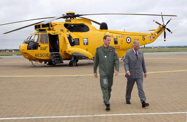Britain's Prince Charles (R) and his son Prince William walk back to the Royal Air Force rescue base after Prince William showed his father around his Sea King helicopter at RAF Valley, in Valley, Wales in a July 9, 2012 file photo. The British government is selling its helicopter search and rescue operations to U.S.-based Bristow Group Inc, Sky News reported on Monday. The exact value of the deal has not been confirmed, but it is expected to be in the region of 3 billion pounds, Sky News said.       REUTERS/Pool/Files (BRITAIN - Tags: ENTERTAINMENT BUSINESS ROYALS MILITARY POLITICS)