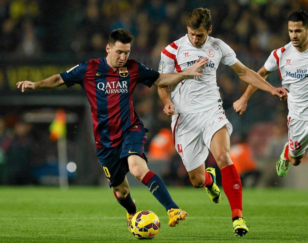 Leo Messi i Grzegorz Krychowiak