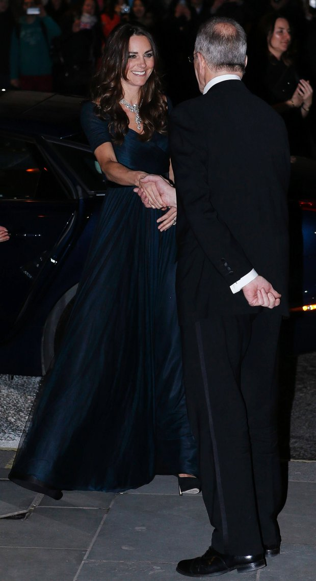 Britain's Catherine, the Duchess of Cambridge, greets Sandy Nairne, Director of the National Portrait Gallery, as she arrives at the National Portrait Gallery's Portrait Gala 2014 in central London February 11, 2014. REUTERS/Olivia Harris (BRITAIN - Tags: ENTERTAINMENT ROYALS)