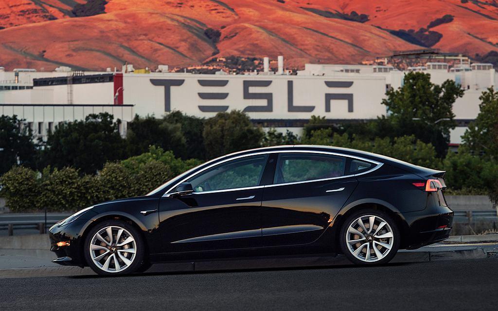 Earns Tesla