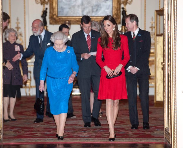 Britain's Queen Elizabeth II walks with Kate, The Duchess of Cambridge, at a Reception for the Dramatic Arts, at Buckingham Palace, London, Monday, Feb. 17, 2014. (AP Photo/David Crump, Pool)