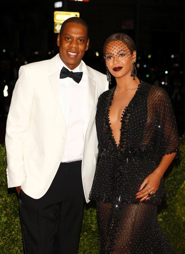 """Rapper Jay Z and singer Beyonce Knowles arrive at the Metropolitan Museum of Art Costume Institute Gala Benefit celebrating the opening of """"Charles James: Beyond Fashion"""" in Upper Manhattan, New York May 5, 2014.  REUTERS/Carlo Allegri (UNITED STATES  - Tags: ENTERTAINMENT FASHION)"""