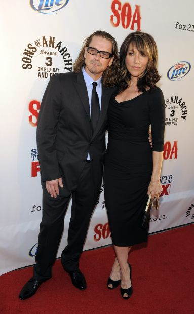 "Kurt Sutter, creator and executive producer of ""Sons of Anarchy,"" poses with his wife and cast member Katey Sagal before a screening of the fourth season premiere of the television series, Tuesday, Aug. 30, 2011, in Los Angeles. The premiere is set on air on the FX network on Sept. 6. (AP Photo/Chris Pizzello)"