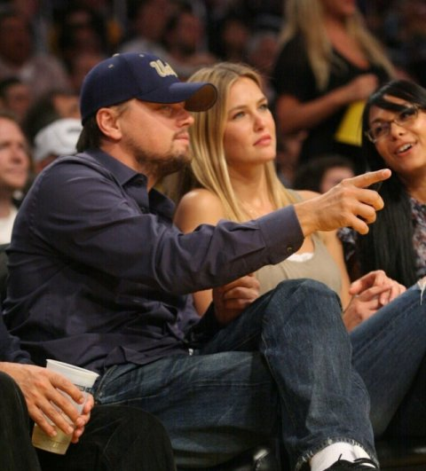 Leonardo DiCaprio and Bar Refaeli having a good time at the LA Lakers game. The Los Angeles Lakers defeated the Oklahoma City Thunder by the final score of 111-87 in game 5 of the West playoffs, held at Staples Center in Los Angeles, CA.  Pictured: Leonardo DiCaprio and Bar Refaeli  Ref: SPL175769  270410   Picture by: London Ent / Splash News