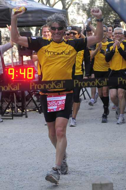 Belgian athlete Stefaan Engels, known as 'marathonman', reacts as he finishes his last marathon in Barcelona, Spain, Saturday, Feb. 5, 2011. Engels, 48, who set a goal of running 365 marathons in 365 days in several cities in Spain and Portugal with the aim of promoting physical activity and demonstrate that the effort is always rewarded, invites everyone to run with him. (AP Photo/Manu Fernandez)