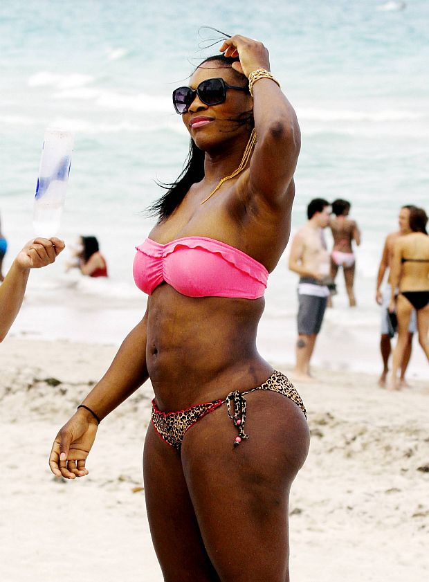 MAVRIXONLINE.COM - DAILY MAIL ONLINE OUT - Professional tennis player Serena Williams shows off her muscular and very fit body in a pink and patterned bikini as she enjoys a beautiful day on the beach with friends where she tanned and snacked on chips and salsa. Miami Beach, FL. 04/16/11,  Fees must be agreed for image use.  Byline, credit, TV usage, web usage or linkback must read MAVRIXONLINE.COM.  Failure to byline correctly will incur double the agreed fee.  .