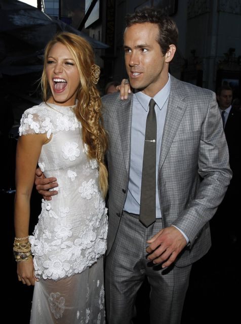 """Cast member Ryan Reynolds, right, and Blake Lively pose together at the premiere of """"Green Lantern"""" in Los Angeles, Wednesday, June 15, 2011. The film will be released June 17.  (AP Photo/Matt Sayles)"""