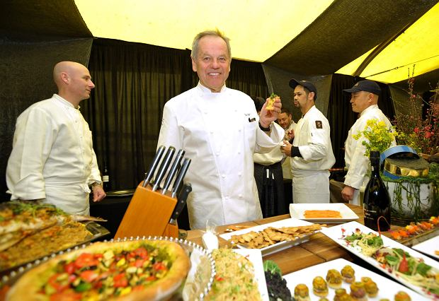 Chef Wolfgang Puck displays sample dishes of the food to be served at the 85th Academy Awards Governor's Ball at the Governor's Ball red carpet preview at The Dolby Theatre on Thursday, Feb. 21, 2012 in Los Angeles. The 85th Annual Academy Awards will take place on Sunday, Feb. 24 at the Dolby Theatre in Los Angeles. (Photo by John Shearer/Invision/AP Photo)