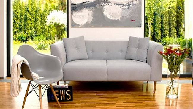 Szary fotel w stylu skandynawskim to model, który nigdy nie wyjdzie z mody