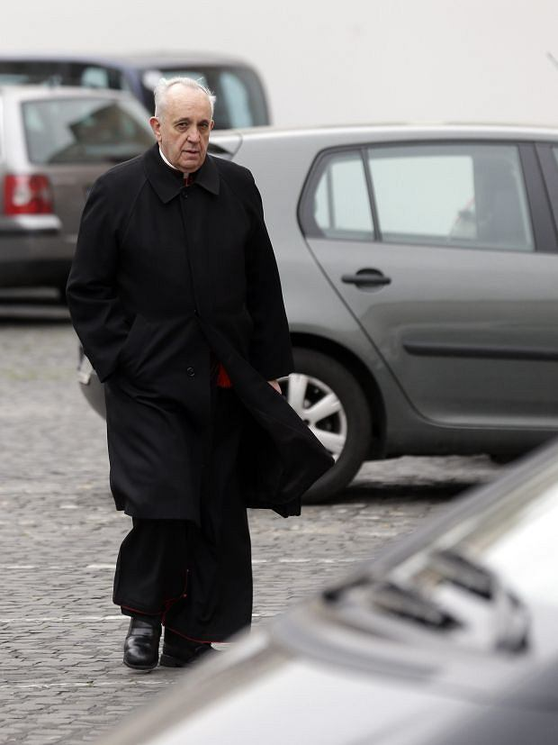 Cardinal Jorge Mario  Bergoglio arrives for a meeting, at the Vatican, Wednesday, March 6, 2013. Cardinals from around the world have gathered inside the Vatican for their first round of meetings before the conclave to elect the next pope, amid scandals inside and out of the Vatican and the continued reverberations of Benedict XVI's decision to retire. (AP Photo/Alessandra Tarantino)