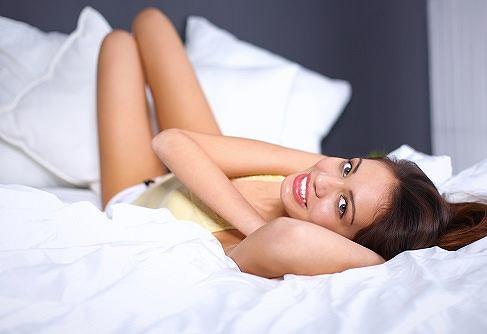 Pretty woman lying  in bed