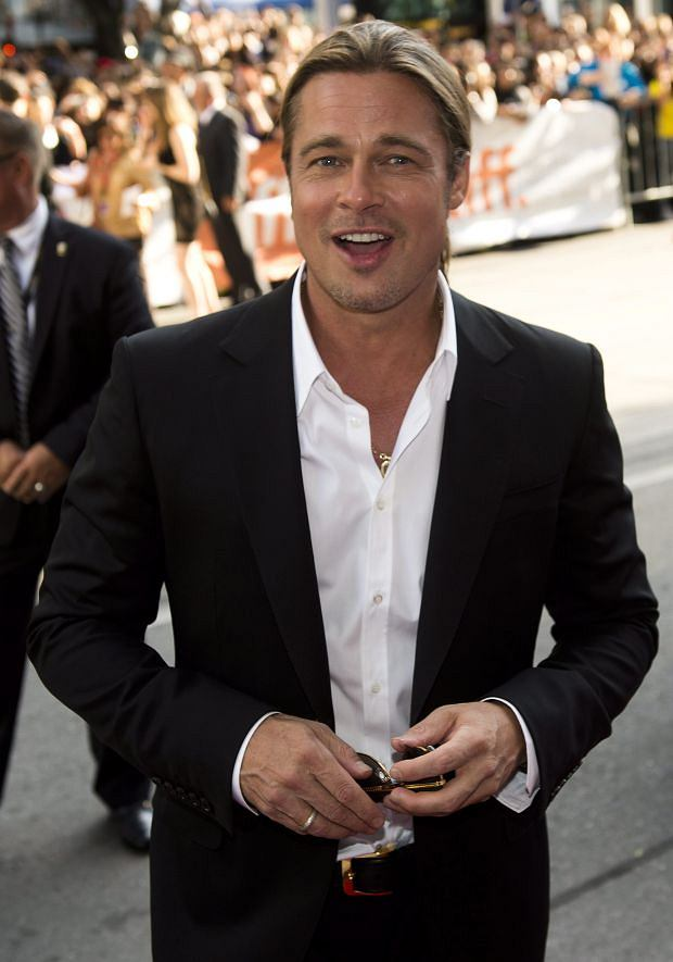 "Actor Brad Pitt poses for photographs on the red carpet at the gala for the new movie ""12 Years a Slave"" during the 2013 Toronto International Film Festival in Toronto on Friday, Sept. 6, 2013. (AP Photo/The Canadian Press, Nathan Denette)"