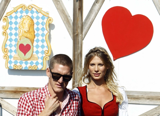 FC Bayern Munich's Bastian Schweinsteiger and his girlfriend Sarah Brandner arrive for a visit at the world biggest beer festival, the Oktoberfest in Munich October 2, 2011. REUTERS/Michael Dalder (GERMANY - Tags: SPORT SOCCER SOCIETY)