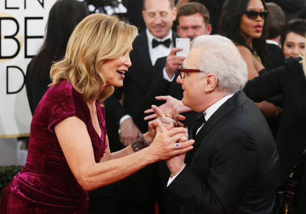 Director Martin Scorsese and actress Jessica Lange talk on the red carpet at the 71st annual Golden Globe Awards in Beverly Hills, California January 12, 2014.  REUTERS/Danny Moloshok  (UNITED STATES - Tags: ENTERTAINMENT) (GOLDENGLOBES-ARRIVALS)