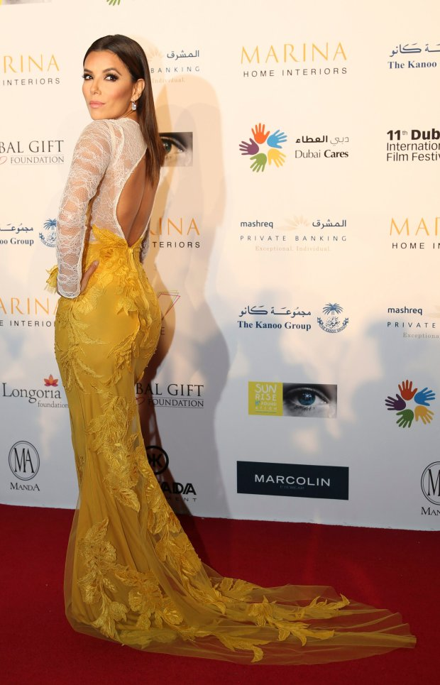 Eva Longoria poses on the red carpet of the Global Gift Gala during day five of the 11th Annual Dubai International Film Festival at the Meydan Racecourse in Dubai, United Arab Emirates, Sunday, Dec. 14, 2014. (AP Photo/Kamran Jebreili)