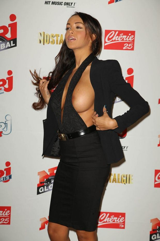 French actress and singer Nabilla Benattia reveals her breast during the NRJ press conference at the Musee quai Branly in Paris.  Pictured: Nabilla Benattia