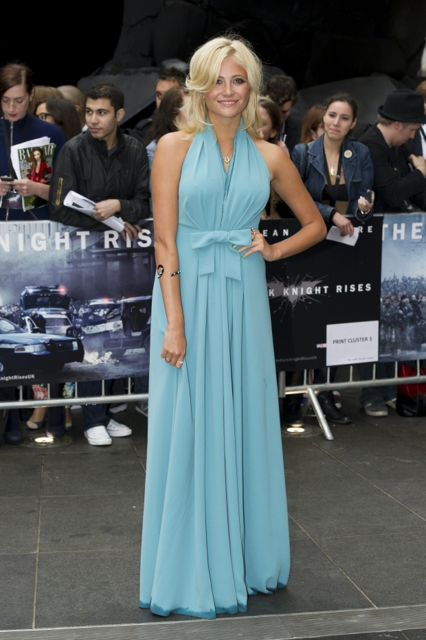 British singer, Pixie Lott, arrives for the European premiere of The Dark Knight Rises, at a central London cinema, Wednesday, July 18, 2012. (AP Photo/Jonathan Short)