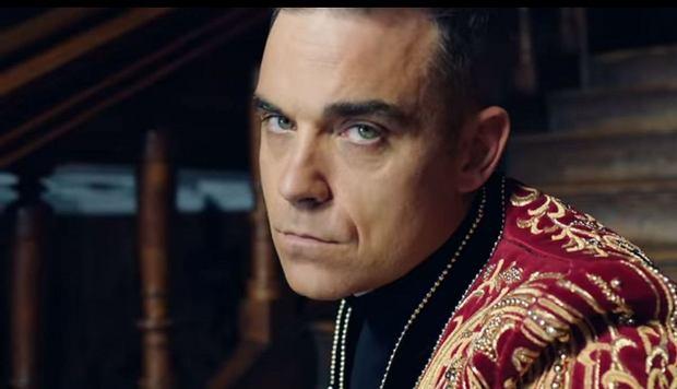 Robbie Williams w teledysku do utworu