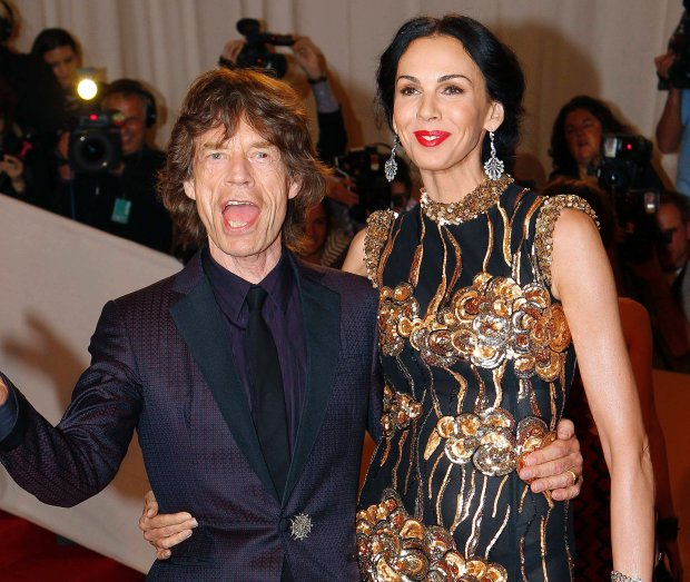 Mick Jagger and designer L'Wren Scott pose on the red carpet at the Metropolitan Museum of Art Costume Institute Benefit celebrating the opening of Alexander McQueen: Savage Beauty, in New York in this May 2, 2011 file photo. Fashion designer L'Wren Scott, the girlfriend of Rolling Stone singer Mick Jagger, was found dead in her New York apartment on March 17, 2014 from an apparent suicide, according a law enforcement official.   REUTERS/Mike Segar/Files   (UNITED STATES - Tags: OBITUARY ENTERTAINMENT PROFILE)