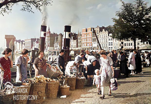 Zdjęcie numer 0 w galerii - Zdjęcia przedwojennego i powojennego Gdańska w kolorze. Zieleń drzew i czerwone cegły Bazyliki Mariackiej