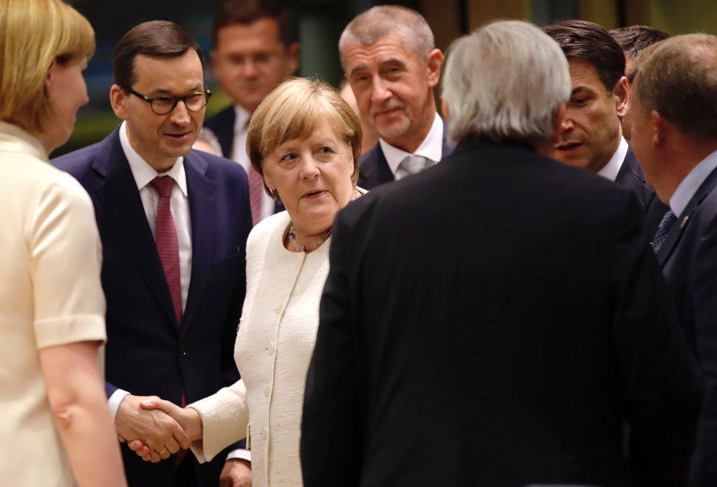 20.06.2019, Bruksela, premier Polski Mateusz Morawiecki witany przez kanclerz Niemiec Angelę Merkel na szczycie Unii Europejskiej.